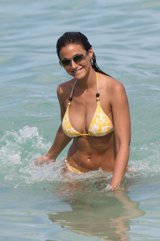 Emmanuelle Chriqui shows off her hot figure in a yellow bikini at a ...