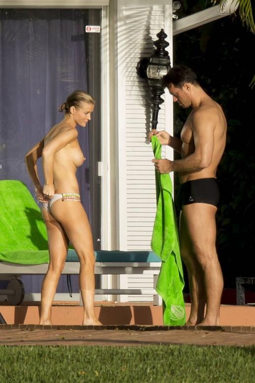 Joanna Krupa sunbathing topless