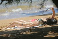 Margot Robbie sunbathing topless