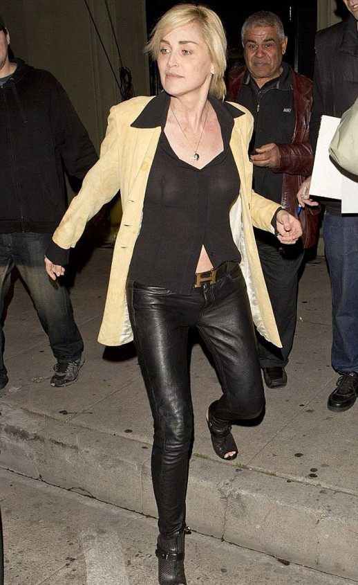 Sharon Stone exposes nipples in a see-through blouse
